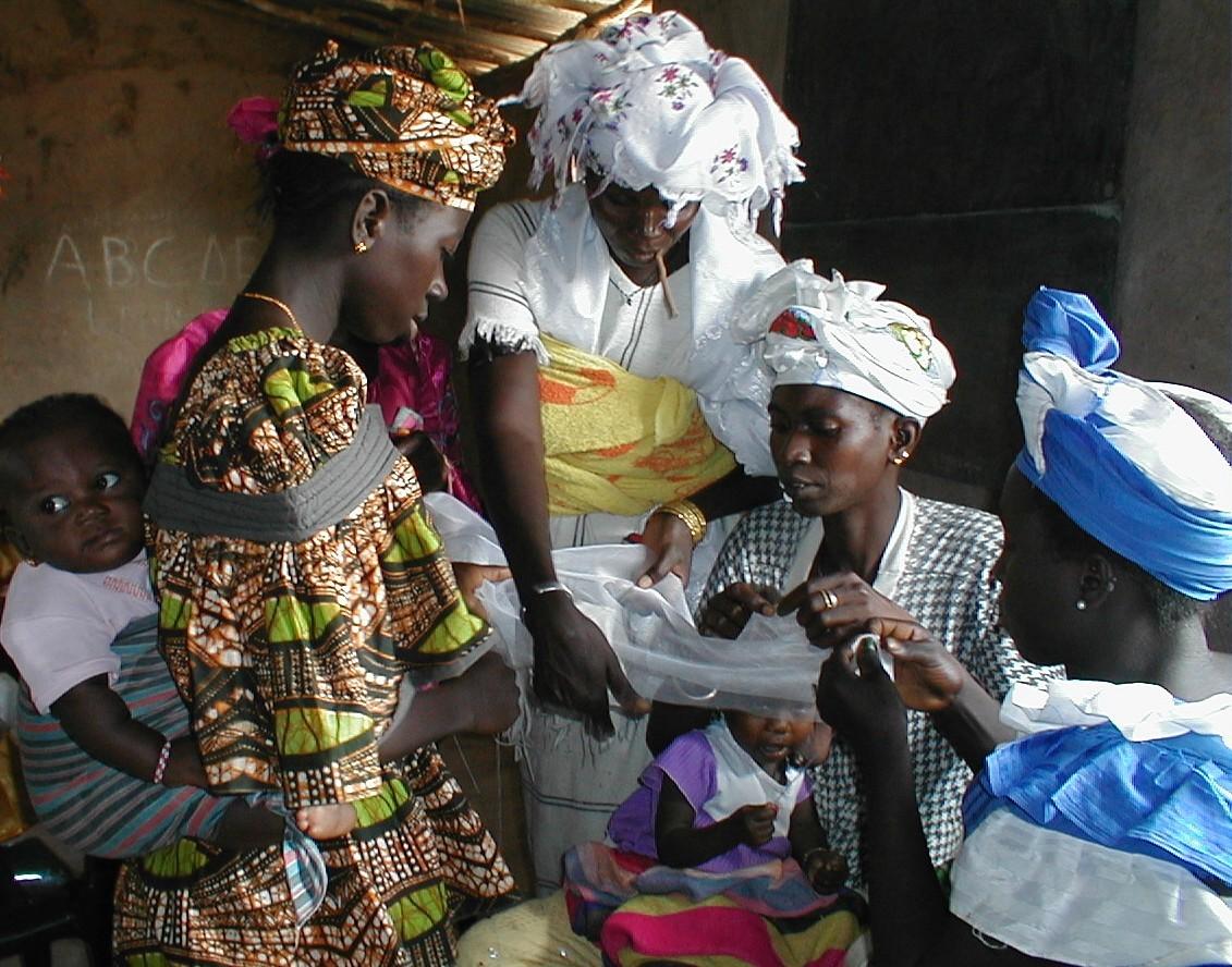 Women stitching nets