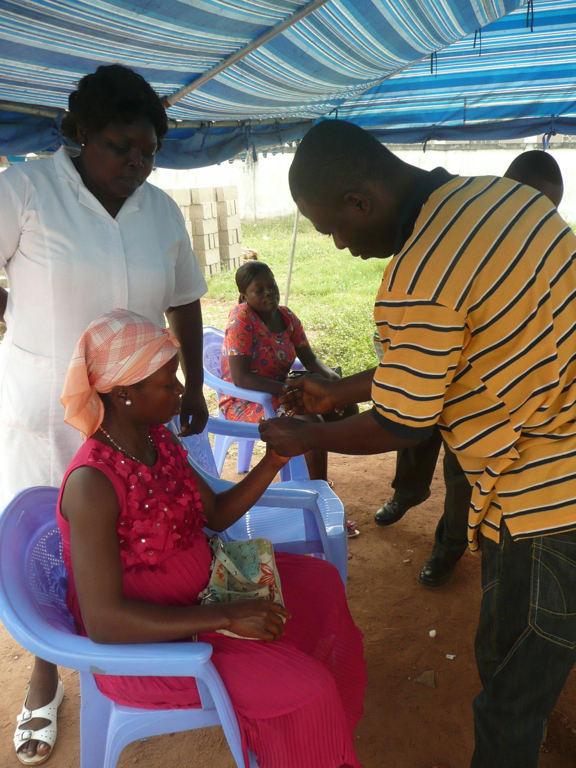 Pregnant woman getting an RDT