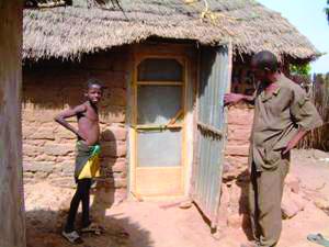 Man and hut