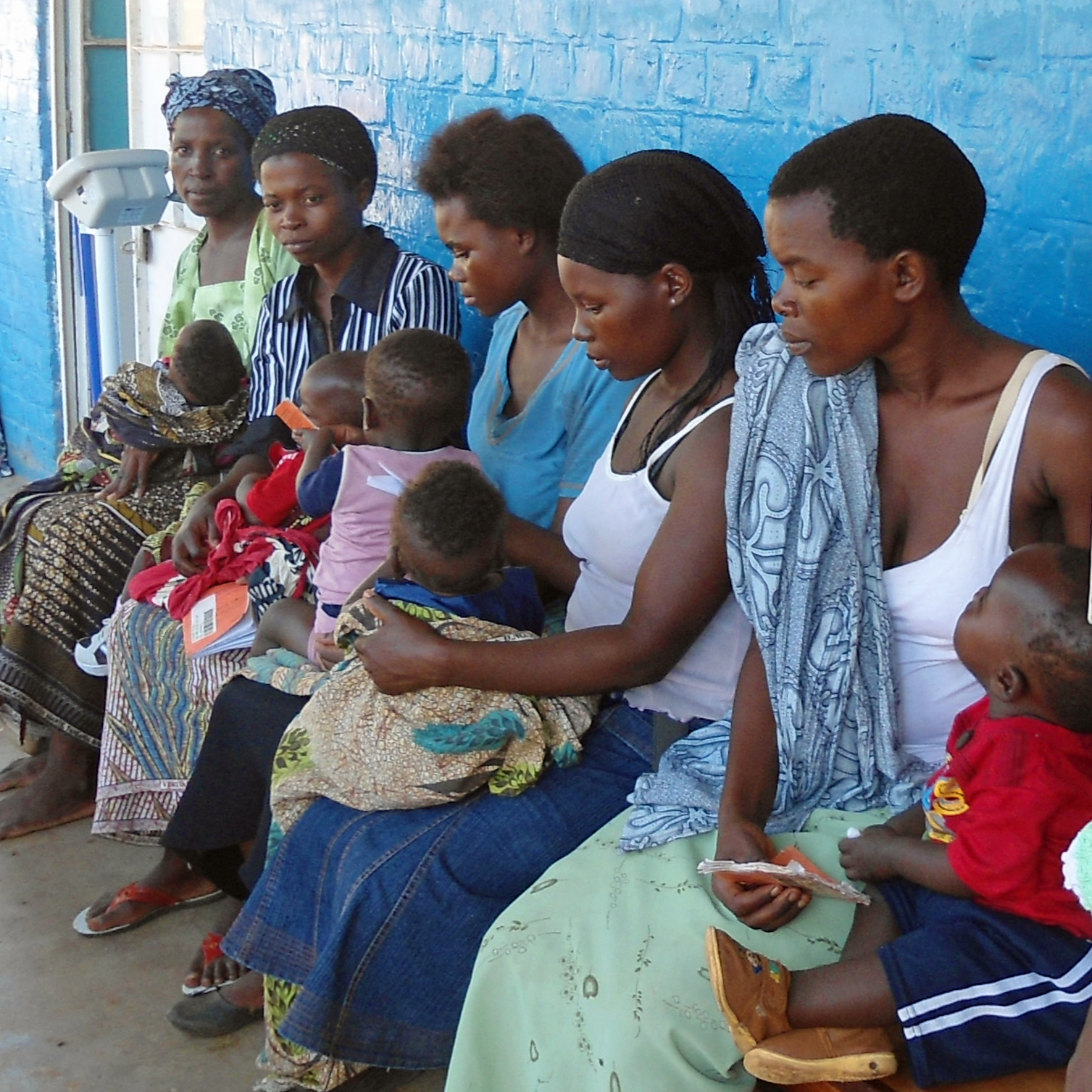 Women and their babies queuing at a clinic