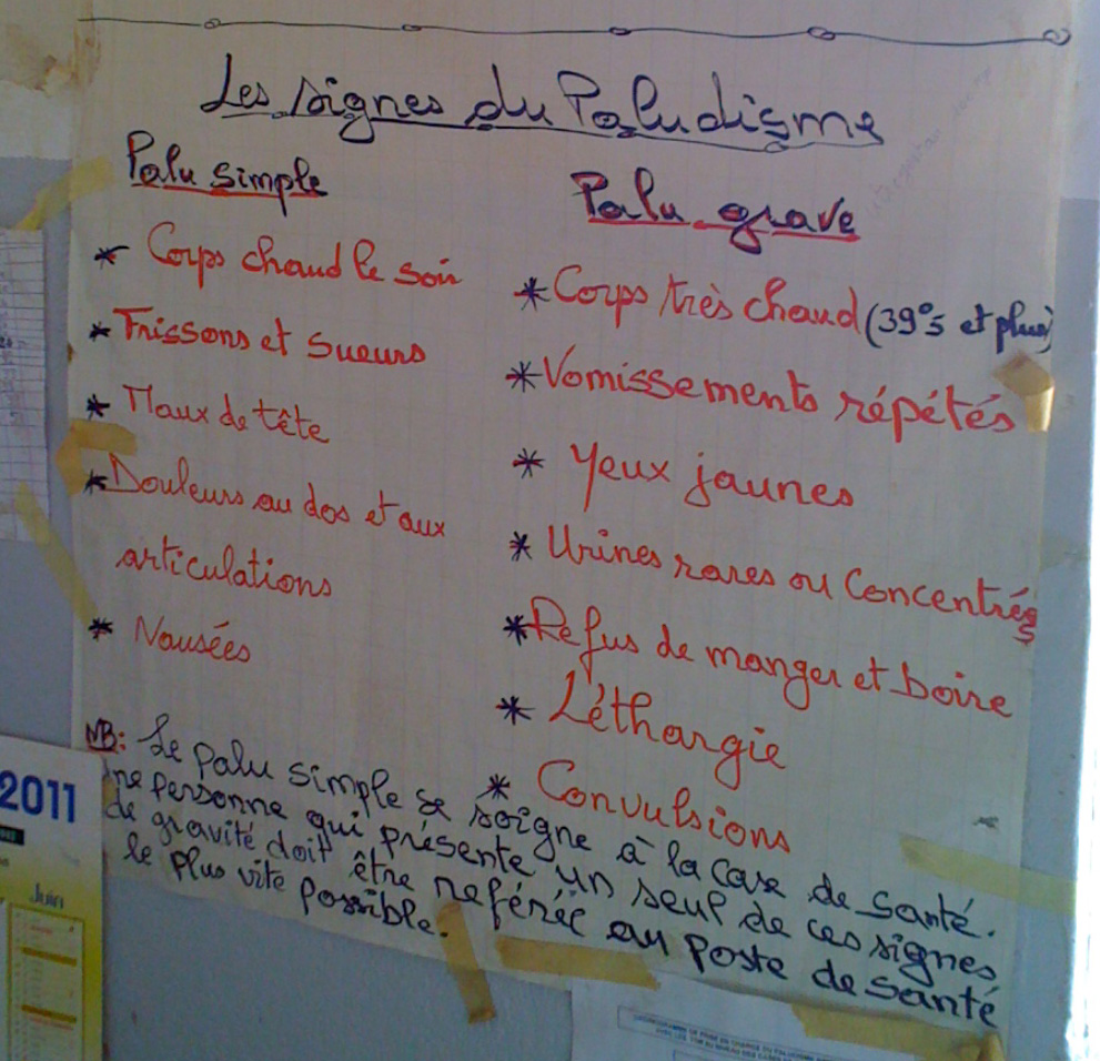 Handwritten poster with list of signs of malaria 'Les signes du Paludisme' Courtesy of Dr Youssoupha Ndiaye