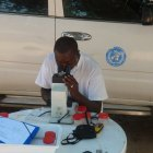 Dr Badara Samb identifying the mosquitoes collected for his study