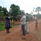 A film crew interview MCDC student in Jinja, Uganda
