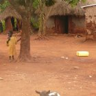 Child and goat in village, Jinja District