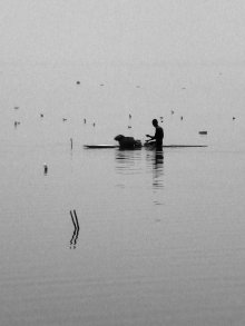 Man fishing from boat, Bosomtwe, Ghana