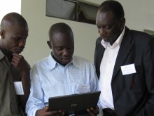 Magatte Ndiaye and Roger Tine being mentored by Badara Cisse