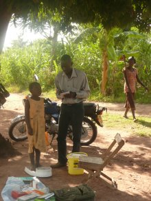 Girl being weighed, Tororo District, Uganda